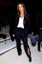 Cindy Crawford topped off her edgy look with a black leather jacket.