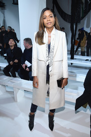 Naomie Harris arrived for the Calvin Klein fashion show looking stylish in a crisp white coat.