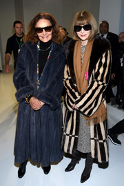 Anna Wintour made a grand entrance in a striped fur coat at the Calvin Klein fashion show.