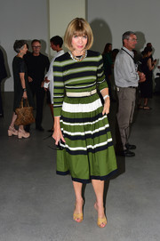 Anna Wintour looked effortlessly stylish in a tricolor striped dress during the Calvin Klein fashion show.