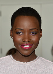 Lupita Nyong'o attended the Calvin Klein fashion show sporting lovely purple eyeshadow.