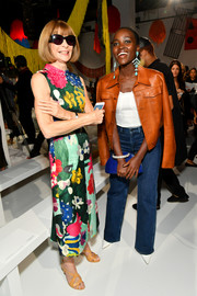 Anna Wintour was a delight to behold in her painterly print dress at the Calvin Klein fashion show.