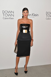 Giovanna Battaglia complemented her dress with a pair of classic black T-strap pumps.