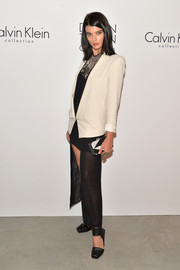 Crystal Renn attended the Calvin Klein post-show event carrying an elegant tricolor box clutch.