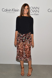 Carine Roitfeld contrasted her sexy skirt with a simple black boatneck sweater.