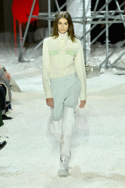 Kaia Gerber was menswear-chic in a pale-yellow button-down with mint-green pocket flaps at the Calvin Klein runway show.
