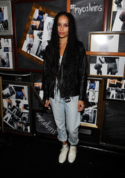 Zoe Kravitz sported her signature rocker-chic style with this black leather jacket and white bralet combo at the Calvin Klein Jeans music event.