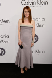 Julianne Moore attended the Calvin Klein party in Cannes wearing a stylish strapless dress in two shades of gray.