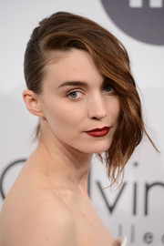 Rooney Mara styled her locks into an updo with a cascade of waves down one side for the Calvin Klein party in Cannes.