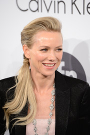 Naomi Watts was fresh-faced at the Calvin Klein party wearing her hair in a neat side ponytail.
