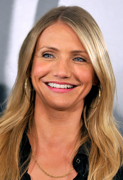 Actress Cameron Diaz attended a photo call for her new film 'The Green Hornet' wearing  Sunrise hoop earrings.