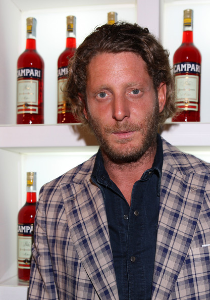 Lapo Elkann sported a slightly disheveled wavy 'do at Milan Vogue's Fashion Night Out.