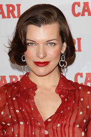 Milla Jovovich wore her classic bob with a few pretty waves at the Campari 2012 calendar press conference.
