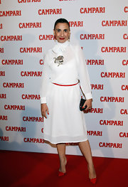 Paola Maugeri wore a white tie-neck long-sleeved dress for the Campari launch.