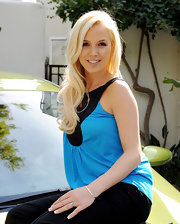 "Amanda Phillips poses for the cameras at the ""If I Can Dream"" house where she showed off her long blonde locks."