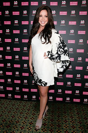 Bristol Palin teamed her kimono style black-and-white dress with taupe suede peep-toe booties.