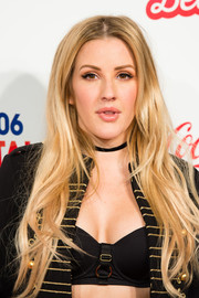 Ellie Goulding wore her long tresses with a center part and subtle waves during Capital's Jingle Bell Ball.