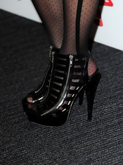 Pixie Lott paired her lace stockings with black platform heels.