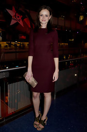 Alexis Bledel accented her maroon bandage dress with a metallic snakeskin clutch.