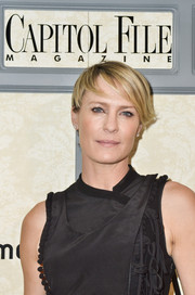 Robin Wright attended Capitol File's WHCD welcome reception wearing a short cut with emo bangs.