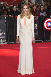 Elizabeth Olsen looked seriously sophisticated at the European premiere of 'Captain America: Civil War' in a slinky white Alexander McQueen gown with a keyhole cutout and knot detailing.