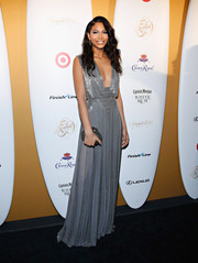 Chanel Iman complemented her gorgeous dress with an embellished oval clutch by Christian Louboutin.