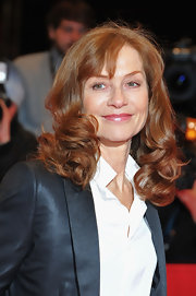 Isabelle Huppert was wearing a masculine outfit but still exuded Old Hollywood glamour with her bouncy curls.