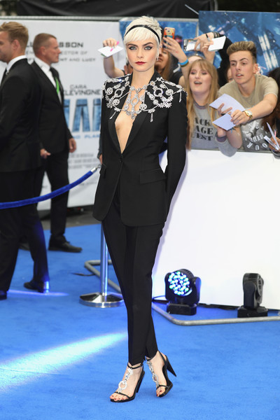 Cara Delevingne Evening Sandals [valerian and the city of a thousand planets,suit,flooring,formal wear,carpet,fashion,girl,red carpet,tuxedo,electric blue,event,cara delevingne,european premiere,european,cineworld leicester square,england,london,red carpet arrivals,premiere]