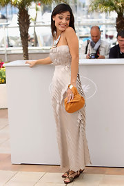 Actress Martina Gusman showed off her fab style while attending the Cannes Film Festival. She paired a lovely day dress with a tan leather clutch.