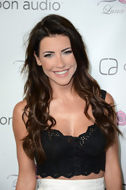 Jacqueline MacInnes Wood complemented her sultry outfit with an oh-so-sweet wavy 'do at the Zooka launch party.