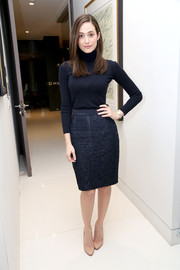 Emmy Rossum bundled up in a black Carolina Herrera turtleneck for the second anniversary of Carbon38.