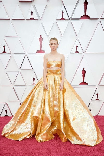 Carey Mulligan Crop Top [handout photo,one-piece garment,dress,neck,sleeve,waist,gown,fashion design,red,flooring,bridal party dress,dress,gown,garment,fashion,clothing,model,california,los angeles,annual academy awards,wedding dress,haute couture,gown,carpet,gown / m,wedding,clothing,model,dress,fashion]