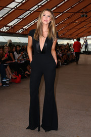 Delta Goodrem looked impossibly tall and slim in a plunging black jumpsuit during the Carla Zampatti 50th anniversary show.