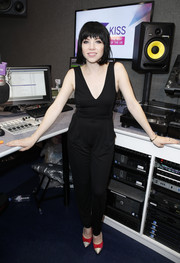 Carly Rae Jepsen showed off her foxy side with this low-cut, figure-flaunting black jumpsuit while visiting Kiss FM.