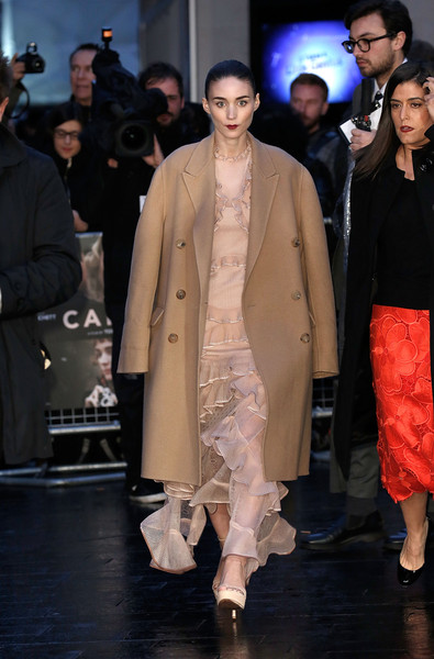 Rooney Mara headed to the BFI London Film Festival wearing a beige wool coat over a ruffled gown.