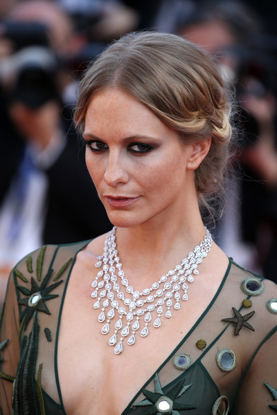 Poppy Delevingne topped off her look with a romantic braided updo.