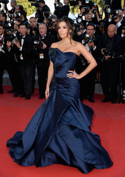 Eva Longoria floated down the 'Carol' premiere red carpet wearing a blue Atelier Versace strapless gown with an architectural neckline, a ruched midsection, and tiers of fabric for the skirt.