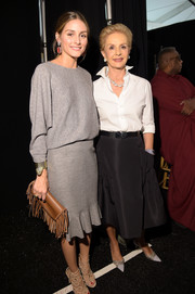 Olivia Palermo was sporty-chic in a gray sweater at the Carolina Herrera fashion show.