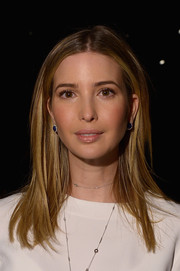 Ivanka Trump opted for a no-frills straight center-parted hairstyle when she attended the Carolina Herrera fashion show.