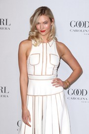 Karlie Kloss paired a gold cuff with a white cutout dress, both by Carolina Herrera, for the Good Girl fragrance launch.