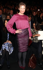 Renee Zellweger topped off her ensemble with burgundy stilettos.