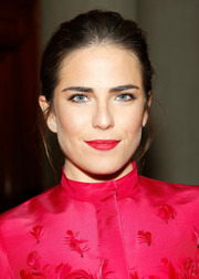 Karla Souza swept her hair back into a simple bun for the Carolina Herrera fashion show.