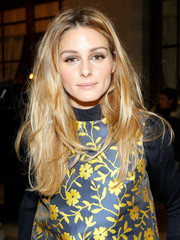 Olivia Palermo looked uncharacteristically low-key with her nude lipstick and gray eyeshadow.