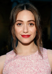 Emmy Rossum attended the Carolina Herrera fashion show wearing her hair in a loose updo with wavy tendrils framing her face.
