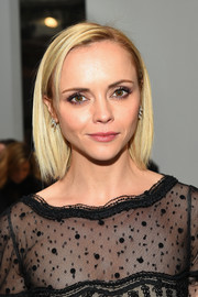 Christina Ricci styled her hair into a simple bob for the Carolina Herrera fashion show.