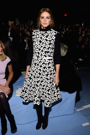 Olivia Palermo made a sweet statement in a black-and-white Carolina Herrera floral frock during the label's fashion show.