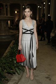 Emily Robinson's bright red tote look gorgeous against her monochrome frock.