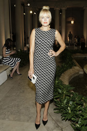 Malin Akerman complemented her frock with a black-and-white box clutch by Lee Savage.