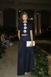 Karlie Kloss looked adorable at the Carolina Herrera fashion show wearing this navy crop-top embellished with three furry flowers.