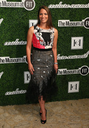 Nicole DiCocco chose a busy-looking cocktail dress, featuring a colorful bodice and an embellished sheer-overlay skirt, for the Couture Council Award luncheon.